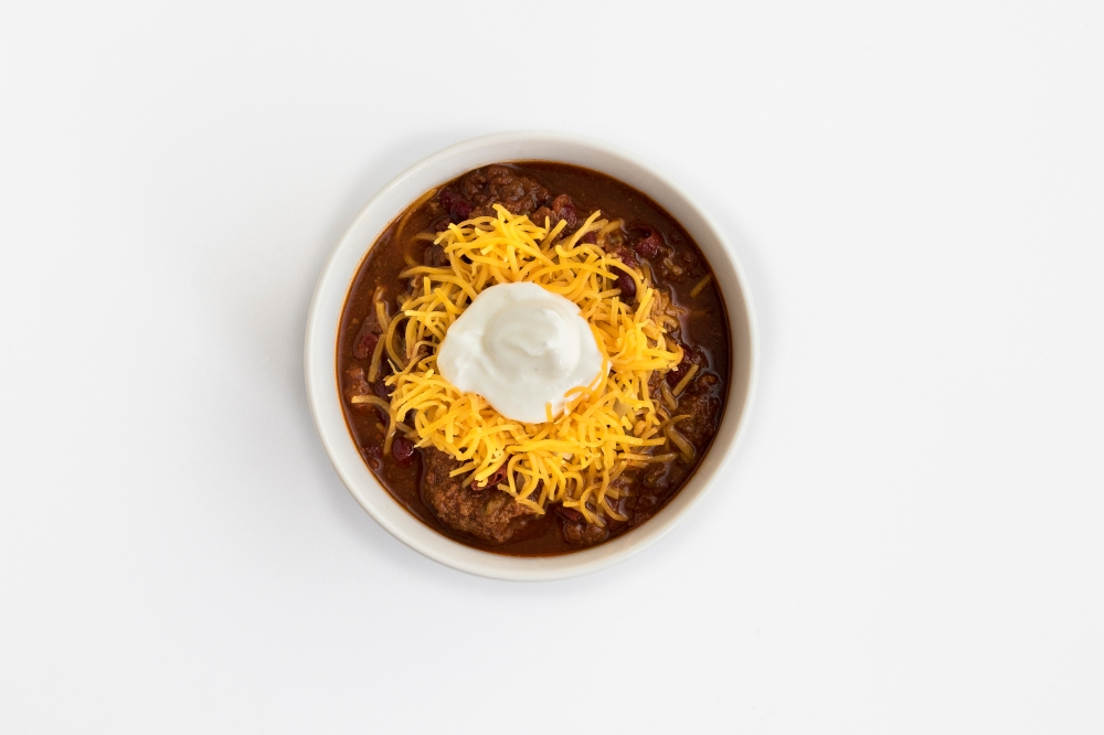 Traditional chili with cheese and sour cream