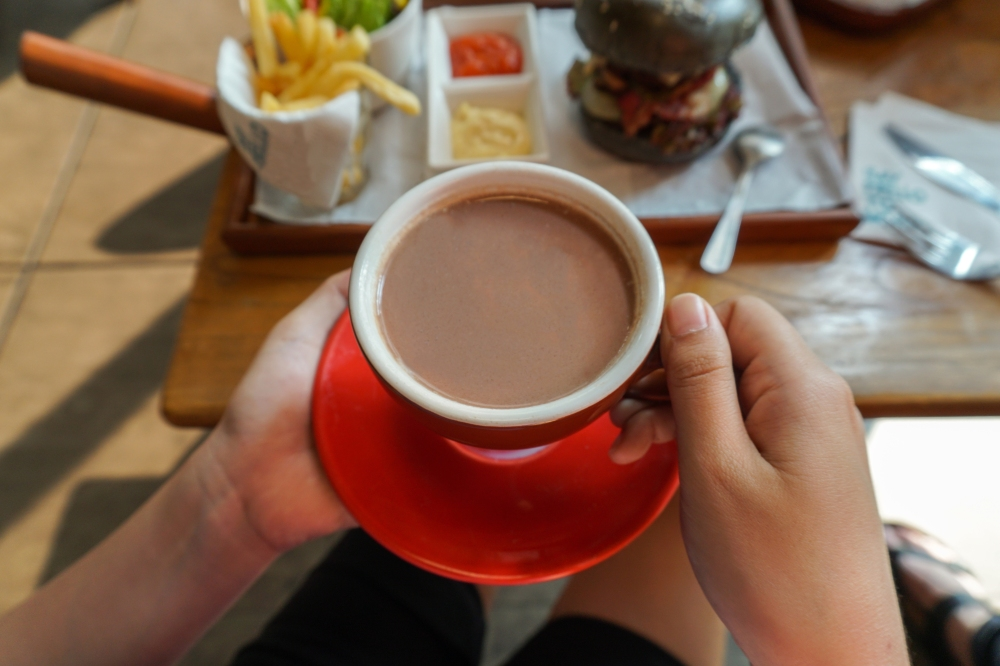 hot cocoa with salty burger and fries